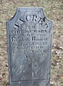 The square-topped headstone style adopted by Hammond in his later work.