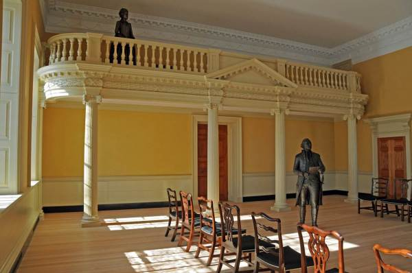 The Old Senate Chamber as it would have appeared on December 23, 1783 during the resignation ceremony of General George Washington. The gallery has been recreated based on historic photographs, physical evidence, and documentary records.