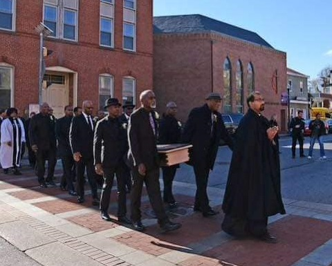 Figure 4: Procession from Asbury UMC to the St. Anne's Cemetery for reburial. Photo credit: Janice Hayes-Williams